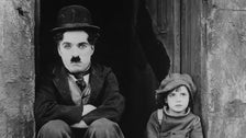 """Charlie Chaplin and Jackie Coogan, publicity photo from """"The Kid"""""""