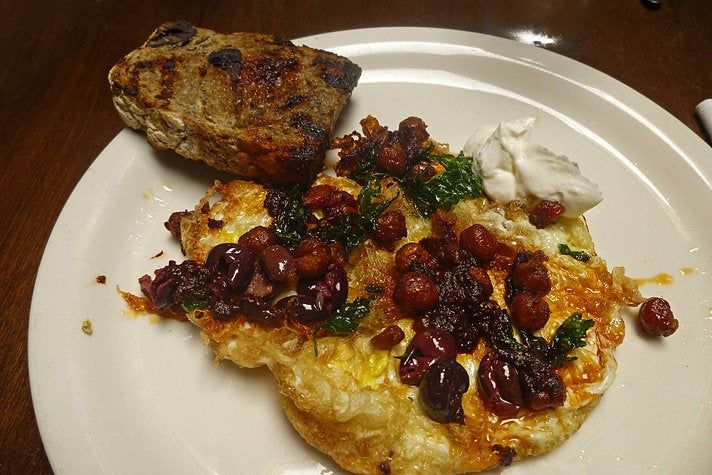 Fried eggs with chickpeas at Cooks County