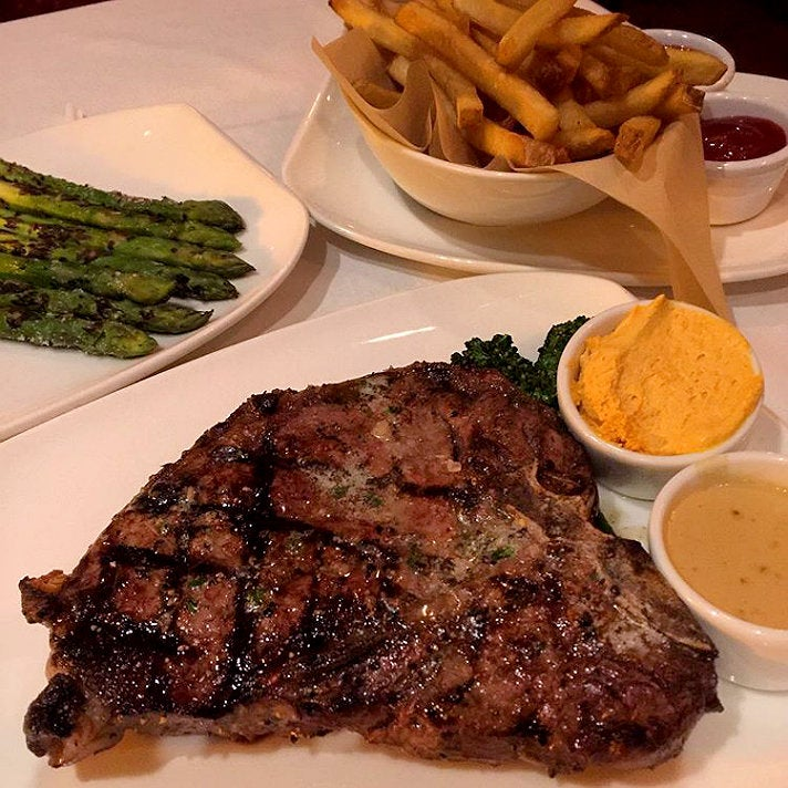 22-oz T-bone steak with au poivre sauce and compound butter at JW's Steakhouse