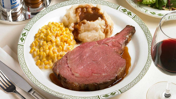 Lawry Cut prime rib dinner with creamed corn and mashed potatoes